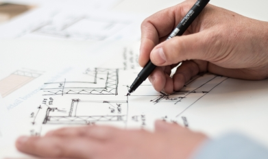man creating an architecture design