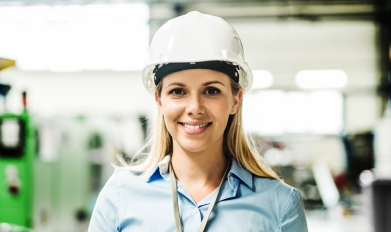 female rural employee wearing hardhat